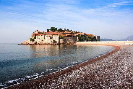 sveti: Sveti Stefan island in Budva, Montenegro.  Silent morning with beautiful  azure sky