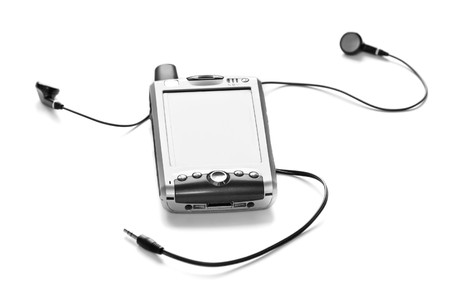 PDA phone with headphones, isolated on white. Narrow DOF with focus on the front of the PDA photo