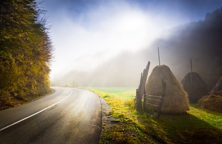 Sunrise on a country road. Foggy autumn morning photo
