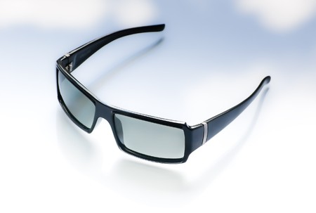 clody: Black sunglasses on a clody background Stock Photo