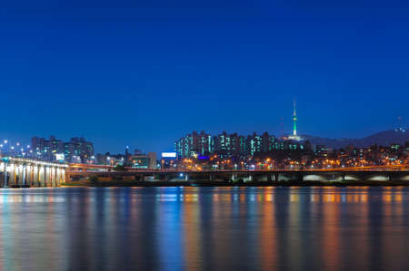 Beautiful landscape view of Namsan mountain with N seoul tower from han river and banpo bridge in twilight time at seoul, south korea