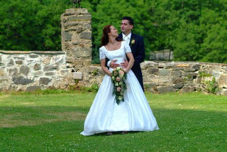 embracement: a bridal couple in garden