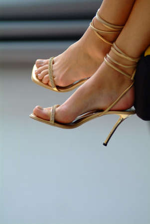 feet in golden high heels