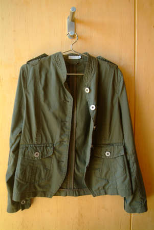 anorak: a shrit is hanging on the wall Stock Photo