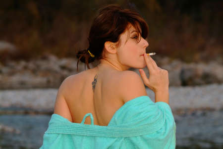 portrait of a smoking woman looking on her right side photo