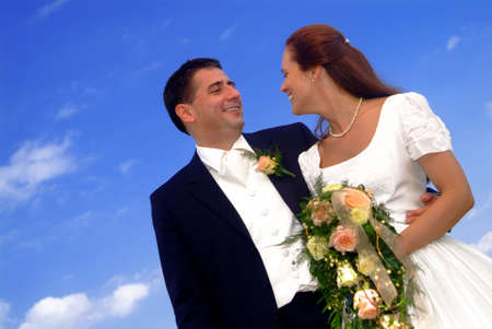 a marriage pair with the blue sky in background