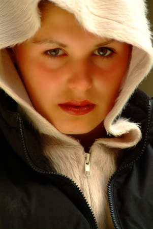 glanz: a young woman looks to you frontal Stock Photo