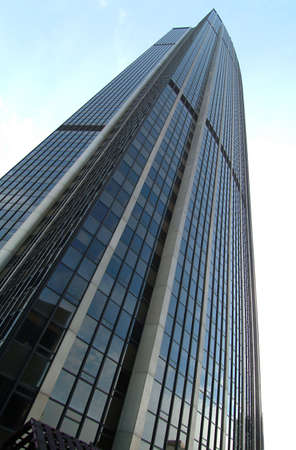 a blue skyscrabber in montparnasse in paris photo