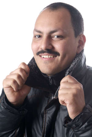 masculin: a friendly man in a black parka with with background Stock Photo