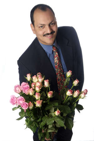 masculin: a man is holding a bouquett with roses
