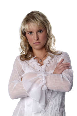 unrestrained: a blond young  woman with folded arms Stock Photo