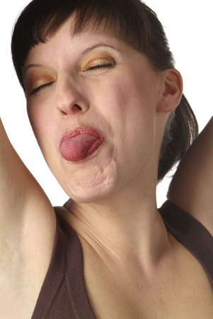 a young dark haired woman shows her tongue Stock Photo