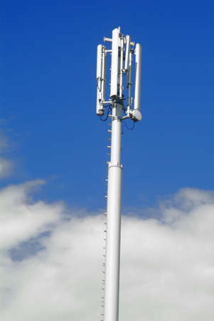 an antenna for mobiles with sky as background
