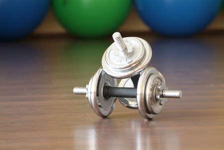 fitnesscenter: two dumbbells on ground of the fitnesscenter