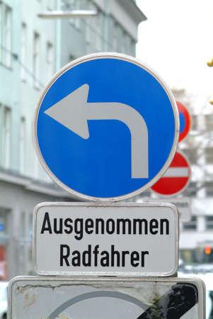 deviate: blue traffic board with a white pictogram