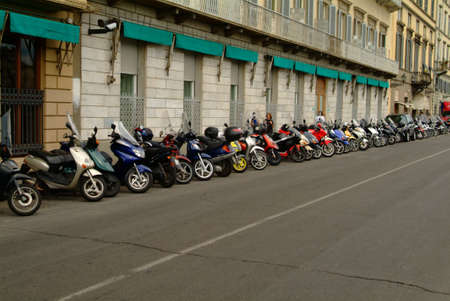 mopeds in one line of an italian restaurant photo