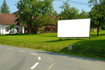 a  roadside billboard  in a beautiful landscape