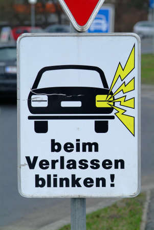 deviate: a white traffic sign with a car beim Verlassen blinken Stock Photo