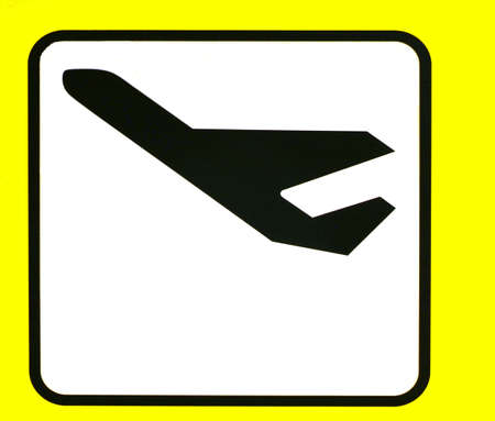a yellow sign with a airplane departures
