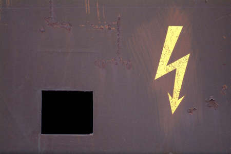 a drawn electricity board on a rusty metal photo
