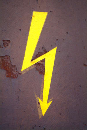 dangerouse: a drawn electricity board on a rusty metal