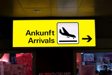 a yellow arrival and departure sign at the airport Stock Photo - 753646