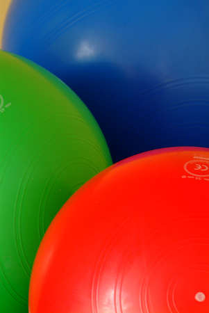 gym balls in blue red and green on the floor