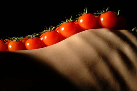 a panicle of tomatoes in skinny torso