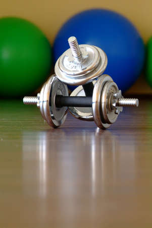 four dumbbells on ground Stock Photo
