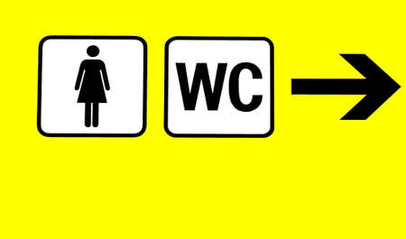 yellow board with symbols for women restroom photo