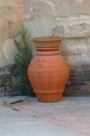 a big brown antique flowerpot of clay photo