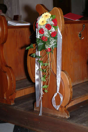 pew: a wedding bouqet of flowers on pew