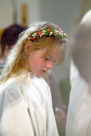 a nice young girl in an angel costume