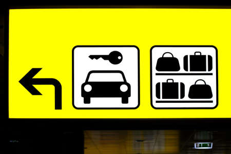 a yellow sign for parking garage and baggage room