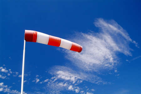 a wind sock and cloudy sky in the background Stock Photo