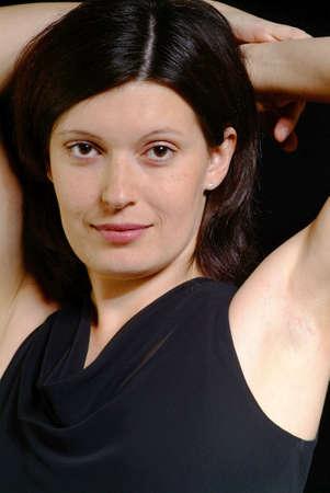 portrait of a friendly woman in the studio photo
