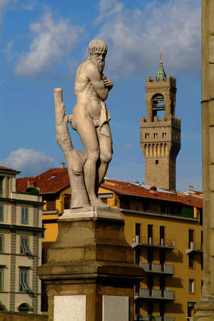 The statue Inverno on the bridge Ponte di Santa Trinita in Florenz