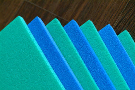 blue green parade of mats on wooden backround Stock Photo