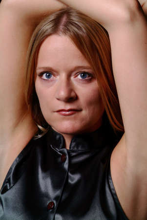 a blond women with both arms over the had
