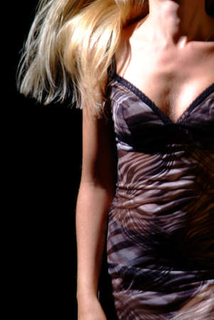 moved women body in a tight-fitting dress on a black backround