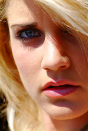 portrait of a young blond women with hair in the face