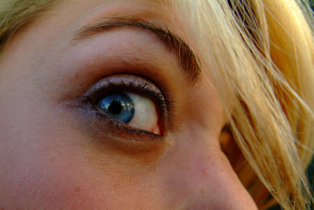 blond women with blue eyes in close-up view Stock Photo