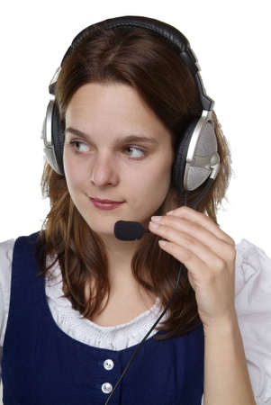 a young woman in dirndl with a head set on Stock Photo