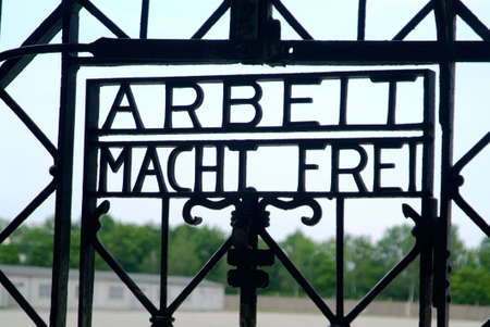 the iron sign arbeit macht frei on the entrance of the former KZ Dachau Stock Photo - 1318829