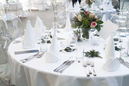 gala: a ceremonial decorated dinner table in white