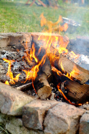 Camp fire at day with burning wood Stock Photo