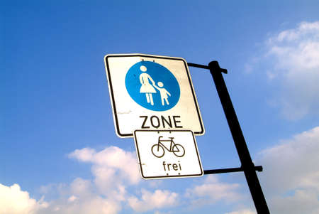 the traffic sign indicates the pedestrian zone and permits bicycle driving photo