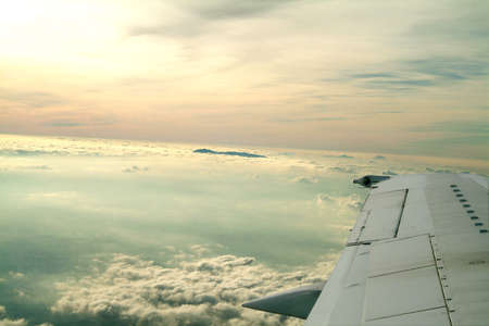 a wing of an airplane and beautiful sky atmosphere Stock Photo