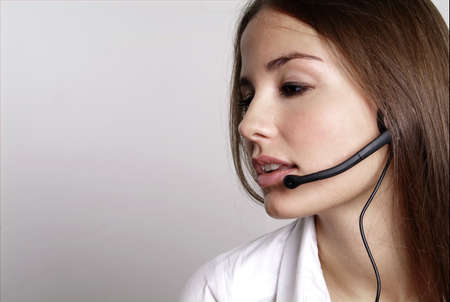 young friendly woman with one headset at the head photo