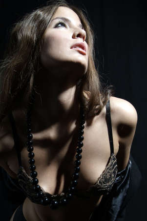 an erotic woman with bra and pearl necklace Stock Photo - 2005439